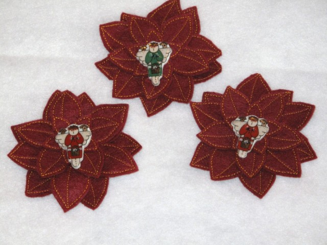 Handcrafted poinsettia pins with Angel buttons